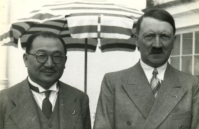 Hitler standing with Chinese emissary Dr. H. H. Kung at Hitler's retreat in the Berchtesgatener Alpen, June 1937