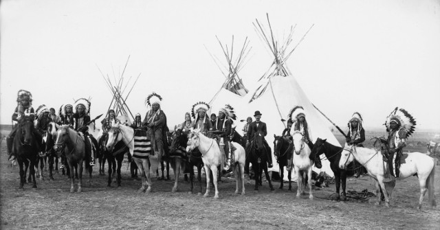 Native American Indians of the Columbia Plateau on horses in front of tipis, 1908 • Photo by Benjamin A. Gifford • Public-domain photo from Wikimedia Commons • https://commons.wikimedia.org