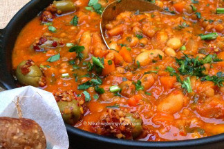 Spicy Bean & Lentil Casserole in a Hearty Pimento Tomato Sauce with Miriam's Walnut Garlic Balls • Click here to get the recipe